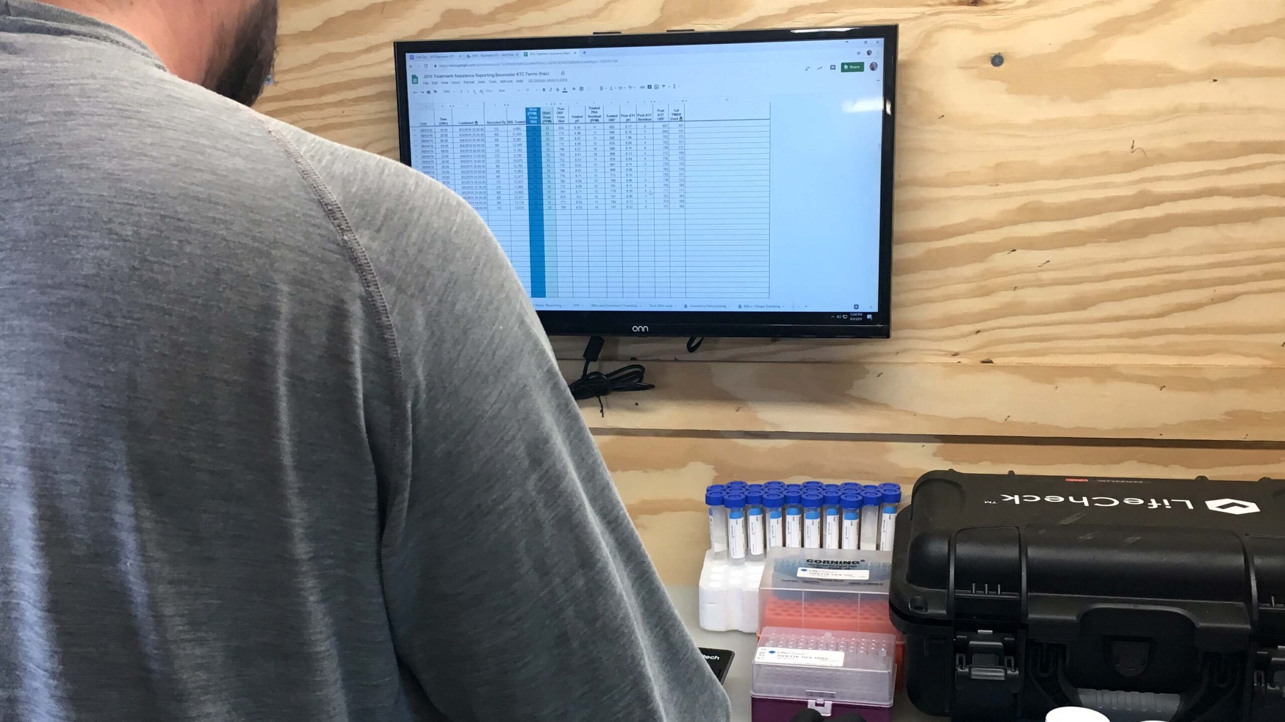 A Clean Chemistry operator enters data on-site.